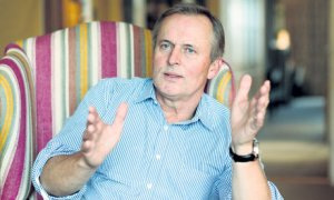 John-Grisham-sitting-in-a-007